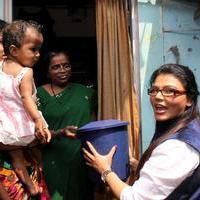 Rakhi Sawant - Rakhi Sawant distributes dustbins to needy people Stills